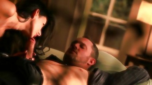 Brown-haired hooker is rounding her lips on the muscular hard stick