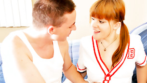 Red haired cheerleader looking at the eyes of man that fingering her clam