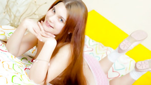 Long haired beauty is smiling like an angel while posing next to camera