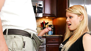 Blonde little whore is about to give her abusing boyfriend a blow job on the kitchen