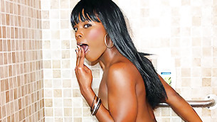Delicious black long haired hooker is showering her chocolate booty